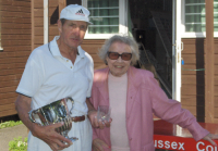 August Tournament: Dick Knapp, Abbey Challenge Cup winner, with Hyacinth Coombs